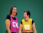 Two women playing netball
