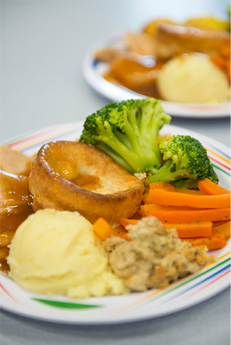 Two plated roast dinners