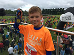 Image of a young boy holding his medal from the Telford Primary schools first half marathon