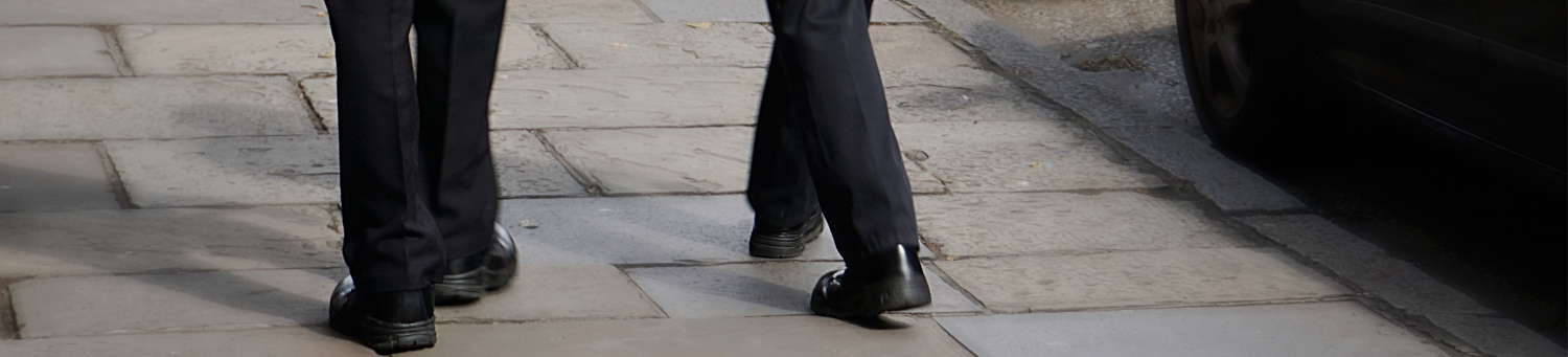 Illustration of two police officers legs patrolling a street